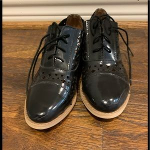 All Black patented leather loafers